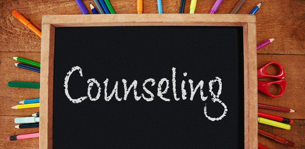 counseling written on chalkboard, surrounded by colorful pencils
